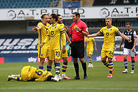 Swansea players surround the referee after a foul on Rhian Brewster of Swansea City during Millwall vs Swansea City, Sky Bet EFL Championship Football at The Den on 30th June 2020