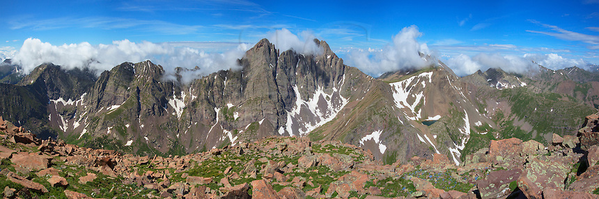 From the 14,064 summit of Humbolt Peak, this panorama shows the majestic Crestone Needle and Crestone Peak, both 14ers, across a beautiful valley of green. The clouds were streaming over the rocky peaks and created a landscape not seen by too many folks.