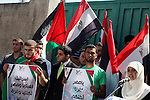 Palestinian youths hold  Palestinian and Egyptian flags Outside the Egyptian embassy on August 9, 2012, in the gaza city , in memory of the 16 Egyptian soldiers who were killed in a militant ambush on August 5, at a checkpoint near the Karm Abu Salem border crossing on the Egypt. Egypt's President Mohamed Morsi prompted the military to launch unprecedented air strikes . and Egyptian authorities closed the border crossing with the Gaza Strip at Rafah indefinitely. Photo by Ashraf Amra
