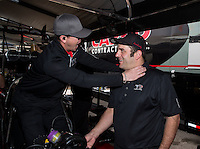 Mar 29, 2014; Las Vegas, NV, USA; NHRA top fuel driver Steve Torrence (left) jokes around with crew member Bobby Lagana during qualifying for the Summitracing.com Nationals at The Strip at Las Vegas Motor Speedway. Mandatory Credit: Mark J. Rebilas-