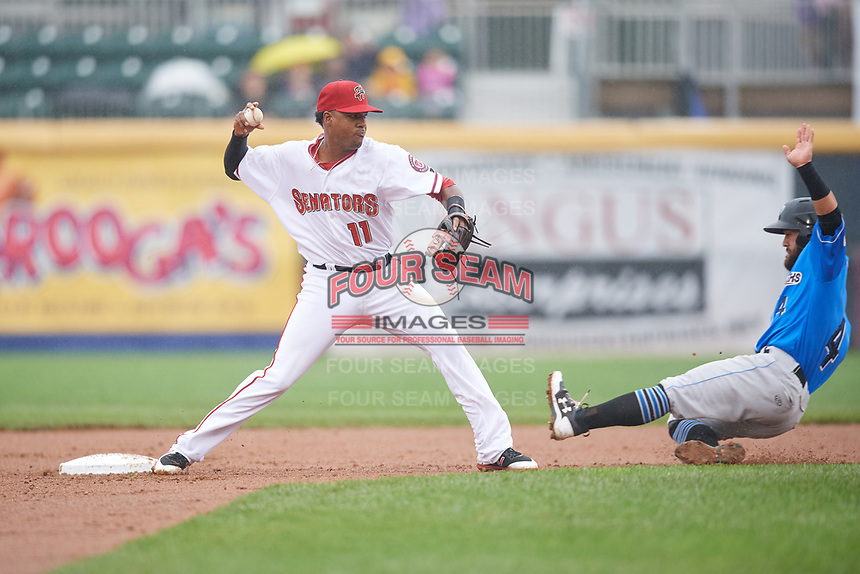 Harrisburg Senators second baseman Osvaldo Abreu (11) records an out at second base and then throws the ball away trying to complete a double play as Ka'ai Tom (4) slides into second base during a game against the Akron RubberDucks on August 19, 2018 at FNB Field in Harrisburg, Pennsylvania.  Akron defeated Harrisburg 3-0 in a rain shortened game.  (Mike Janes/Four Seam Images)