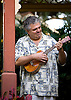 Joe Crocona plays a ukelele made of curly koa wood, on the island of Kauai, Hawaii. Photo by Kevin J. Miyazaki/Redux