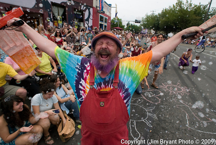 Gary GoLighty yells after spraying parade-goers with bubbles in the 21st annual Summer Solstice Parade held Saturday, June 20, 2009 in Seattle, Wa. The parade was held Saturday, bringing out painted and naked bicyclists, bands, belly dancers and floats. (Jim Bryant Photo © 2009).