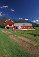 AJ4526, barn, farm, Vermont, Red barn in scenic setting with blue sky and white clouds in Waterbury Center in Washington County in the state of Vermont.