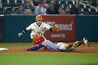 Greensboro Grasshoppers third baseman Patrick Dorrian (15) fields a throw as Juan Pascal (10) of the Hagerstown Suns slides into third base at First National Bank Field on April 6, 2019 in Greensboro, North Carolina. The Suns defeated the Grasshoppers 6-5. (Brian Westerholt/Four Seam Images)