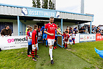 Jersey's Captain Luke Campbell leads his team onto the pitch. Yorkshire v Parishes of Jersey, CONIFA Heritage Cup, Ingfield Stadium, Ossett. Yorkshire's first competitive game. The Yorkshire International Football Association was formed in 2017 and accepted by CONIFA in 2018. Their first competative fixture saw them host Parishes of Jersey in the Heritage Cup at Ingfield stadium in Ossett. Yorkshire won 1-0 with a 93 minute goal in front of 521 people. Photo by Paul Thompson