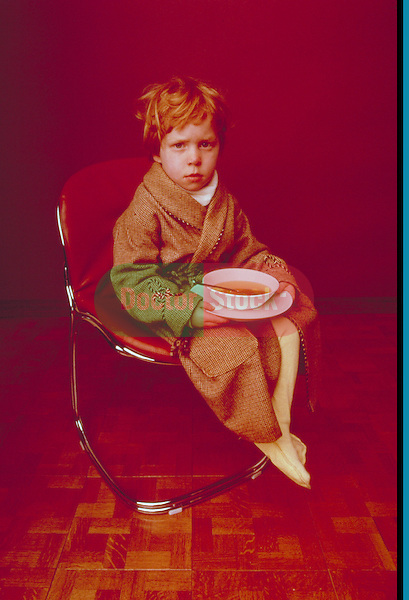 boy with a cold sitting with a bowl of soup