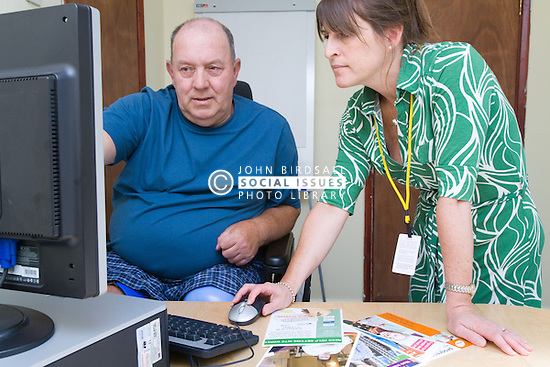 Disabled man looking for jobs with Disability Employment Adviser,