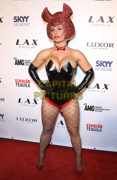 """Nicole """"Coco"""" Austin  .Ice-T and Coco host the ultimate """"Player's Ball"""" at LAX nightclub inside the Luxor Resort Hotel and Casino, Las Vegas, Nevada, USA..29th October 2011.full length fishnet stockings corset strapless gloves cleavage hair red black costume helmet sparkly hands on hips.CAP/ADM/MJT.© MJT/AdMedia/Capital Pictures."""