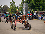 Tractor parade by the midway, Sunday at the 80th Amador County Fair, Plymouth, Calif.<br /> .<br /> .<br /> .<br /> .<br /> #AmadorCountyFair, #1SmallCountyFair, #PlymouthCalifornia, #TourAmador, #VisitAmador