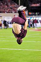 Blacksburg, VA - SEPT 30, 2017: Virginia Tech Hokies cheerleader does a back flip before game between Clemson and Virginia Tech at Lane Stadium/Worsham Field Blacksburg, VA. (Photo by Phil Peters/Media Images International)