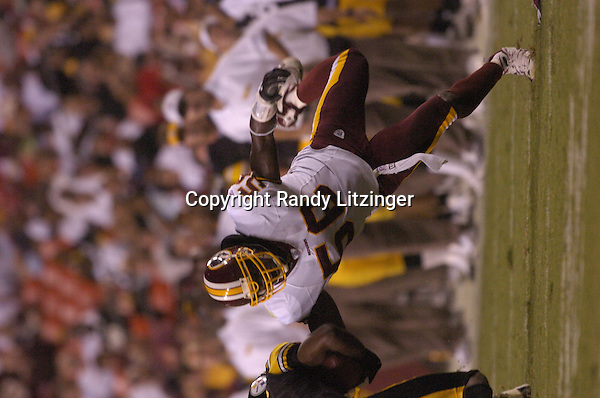 26 August 2005:  LaVar Arrington (56) tackles Steelers WR Fred Gibson in open field.The Washington Redskins defeated the Pittsburgh Steelers 17-10 during preseason game August 26, 2005 at Fed Ex Field in Landover, MD.