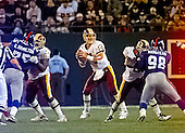 Washington Redskins quarterback Brad Johnson (14) looks for a receiver as New York Giants defensive tackle Keith Hamilton (75) and linebacker Jessie Armstead (98) provide pressure during the game at Giants Stadium in East Rutherford, New Jersey on September 24, 2000.  <br /> Blocking for Johnson are offensive guard Keith Sims (63) and running back Adrian Murrell (22).  The Redskins won the game 16 - 6.<br /> Credit: Arnie Sachs / CNP
