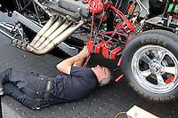 Apr. 26, 2013; Baytown, TX, USA: NHRA crew member Johnny West for funny car driver Cruz Pedregon during qualifying for the Spring Nationals at Royal Purple Raceway. Mandatory Credit: Mark J. Rebilas-
