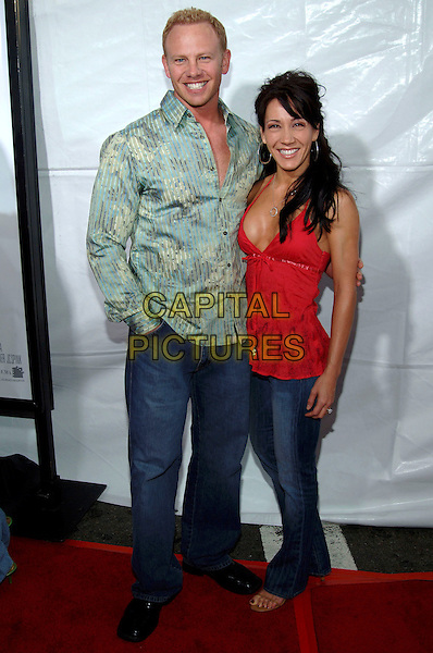 "IAN ZIERING & LISA RAGLAND.Los Angeles Premiere of ""Monster-In-Law"" held at Mann Village Theatre..April 29th, 2005.Photo credit: Jacqui Wong/AdMedia.full length green shirt red top jeans denim hand in pocket.www.capitalpictures.com.sales@capitalpictures.com.© Capital Pictures."