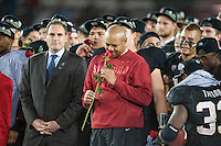 STANFORD, CA-NOVEMBER 30, 2012 - David Shaw takes in the scent of a rose after winning the PAC-12 Championship at Stanford Stadium. The Stanford Cardinal advances to the Rose Bowl with a 27-24 win over the UCLA Bruins.