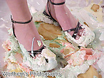 A closer look that this pretty model's creamy sexy toes covered from a whipped cream pie.