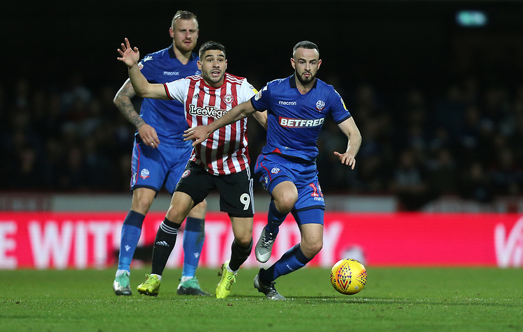Bolton Wanderers' Marc Wilson and Brentford's Neal Maupay<br /> <br /> Photographer Rob Newell/CameraSport<br /> <br /> The EFL Sky Bet Championship - Brentford v Bolton Wanderers - Saturday 22nd December 2018 - Griffin Park - Brentford<br /> <br /> World Copyright © 2018 CameraSport. All rights reserved. 43 Linden Ave. Countesthorpe. Leicester. England. LE8 5PG - Tel: +44 (0) 116 277 4147 - admin@camerasport.com - www.camerasport.com