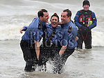 Garda members Patrick Sheridan, Aoife Kelly and Dave Rothwell who took part in the Polar Plunge in aid of the Special Olympics at Clogherhead beach, County Louth. Photo:Colin Bell/pressphotos.ie