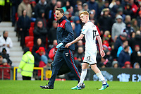 Sam Clucas of Swansea City leaves the pitch through injury during the Premier League match between Manchester United and Swansea City at the Old Trafford, Manchester, England, UK. Saturday 31 March 2018