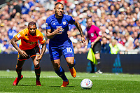 Kenneth Zohore of Cardiff City gets away from Leandro Bacuna of Reading during the Sky Bet Championship match between Cardiff City and Reading at the Cardiff City Stadium, Cardiff, Wales on 6 May 2018. Photo by Mark  Hawkins / PRiME Media Images.