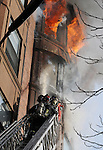 (Boston Ma 020114) Bostin Firefighters from Ladder 15, pour water on the  5th floor as fire extends to the sixth floor in the rear at 31 Massachusetts  Ave, during the fire that went to seven alarms. (Jim Michaud  Photo) For Sunday