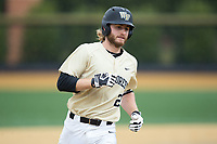 Johnny Aiello (2) of the Wake Forest Demon Deacons rounds the bases after hitting a home run against the Georgia Tech Yellow Jackets at David F. Couch Ballpark on March 26, 2017 in  Winston-Salem, North Carolina.  The Demon Deacons defeated the Yellow Jackets 8-4.  (Brian Westerholt/Four Seam Images)