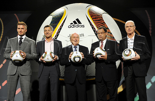 (L-R) England international David Beckham, adidas CEO Herbert Hainer, FIFA President Joseph Blatter, Danny Jordaan, managing director of the organisation committee, and German soccer legend Franz Beckenbauer pose as Jabulani, the official ball for the FIFA 2010 World Cup South Africa, is handed over in Cape Town, South Africa, 04 December 2009. Jabulani is produced by German company adidas. Photo: BERND WEISSBROD/actionplus. UK Licenses Only.