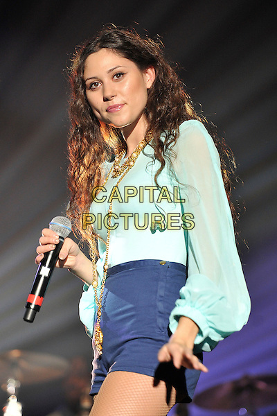 Eliza Doolittle .Performing live at the 'Girlguiding UK  Big Gig' at Wembley Arena, London, UK, 1st October 2011..music concert  live on stage half length turquoise top long sleeves microphone  hotpants blue shorts  gold necklace .CAP/MAR.© Martin Harris/Capital Pictures.