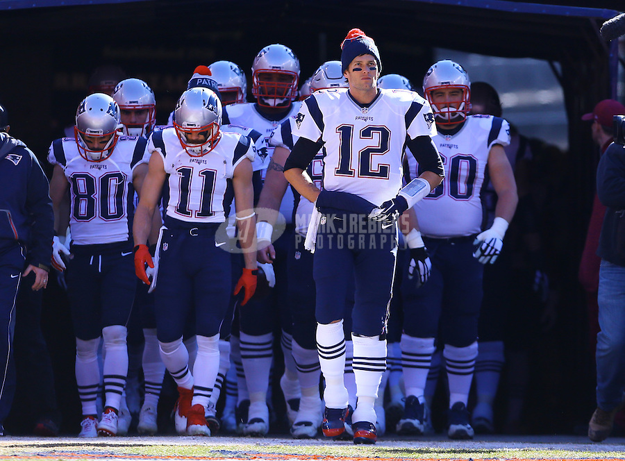 Jan 24, 2016; Denver, CO, USA; New England Patriots quarterback Tom Brady (12) leads his team onto the field against the Denver Broncos in the AFC Championship football game at Sports Authority Field at Mile High. Mandatory Credit: Mark J. Rebilas-USA TODAY Sports