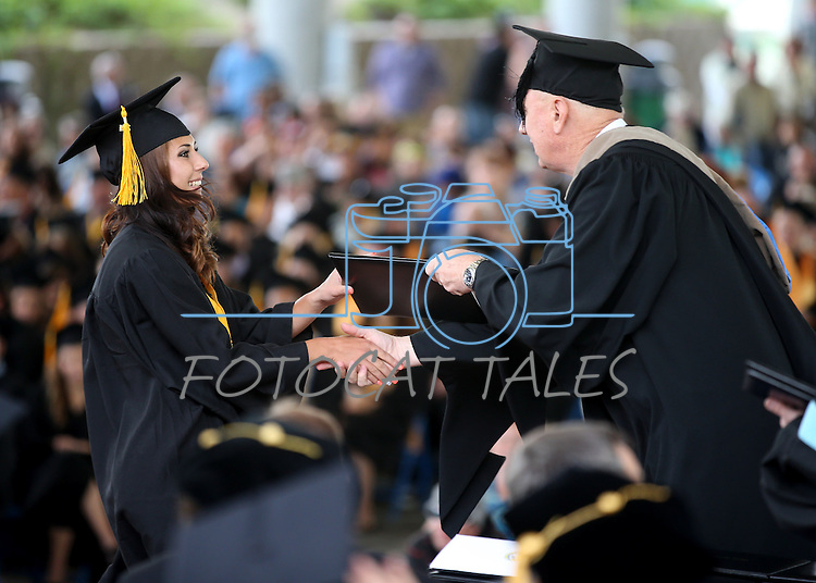Interim President Chester Burton congratulates Madison Gonzalez during at the Western Nevada College commencement at the Pony Express Pavilion, in Carson City, Nev., on Monday, May 19, 2014. <br /> Photo by Cathleen Allison/Nevada Photo Source
