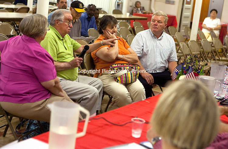 TORRINGTON, CT- MAY 27 2010-052710JS01-Torrington North End resident Don Heuschkel, center, asks a question to Torrington Mayor Ryan J. Bingham, as neighbor Betsy Qwartiero, left, his wife Carmels Heuschkel and moderator Glenn Royals, right, listen during a Meet the Mayor and City Officals forum Thursday at St. Maron's Church in Torrington. The event was hosted by the North End Community Association. <br /> Jim Shannon Republican-American