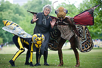 PICTURE BY ALEX BROADWAY/SWPIX.COM...17/05/11- Get Britain Buzzing Launch - St. James Park, London...Germaine Greer poses for pictures with the Insect Circus Acrobatics Troupe. See Buglife press release