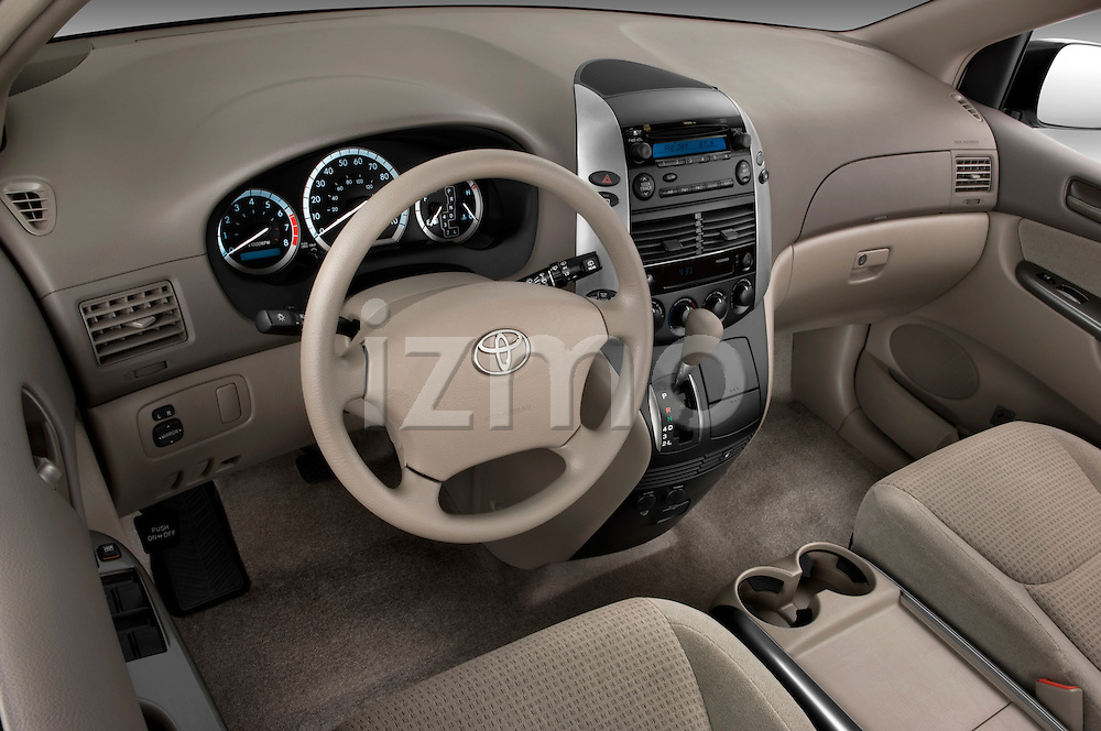 High angle dashboard view of a 2010 Toyota Sienna CE 8 Passenger