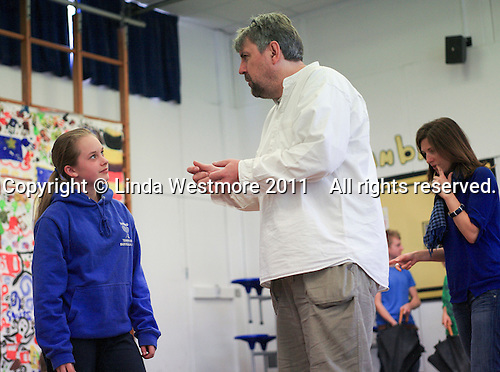 "Adam Forde, Director, and ""Lucy"".  The Yvonne Arnaud Youth Theatre rehearsing ""The Lion, the Witch and the Wardrobe"", Guildford, Surrey."