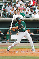 Augusta GreenJackets outfielder Cristian Paulino (9)at bat during a game against the Charleston Riverdogs at Joseph P.Riley Jr. Ballpark on April 15, 2015 in Charleston, South Carolina. Charleston defeated Augusta 8-0. (Robert Gurganus/Four Seam Images)
