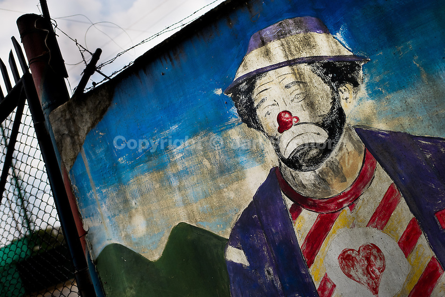 "A painted artwork, depicting a vagabond clown, appears on the wall close to the circus school Circo para Todos in Cali, Colombia, 29 May 2012. Circo Para Todos (""Circus for All""), founded by Felicity Simpson, a former British circus performer, is the first professional circus school in the world specifically dedicated to disfavoured kids and talented street children. Students are trained in a range of circus art skills including acrobatics, balancing, juggling, stilt walking or unicyling. After finishing the four-year course, graduates may find jobs in circuses in the world or in the cruise ships."