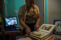 Vicky Delgadillo cries as she flips through a photo album of her missing daughter Yunery Citlally at her home in Xalapa, Mexico on November 4, 2017. <br /> Photo Daniel Berehulak for The New York Times