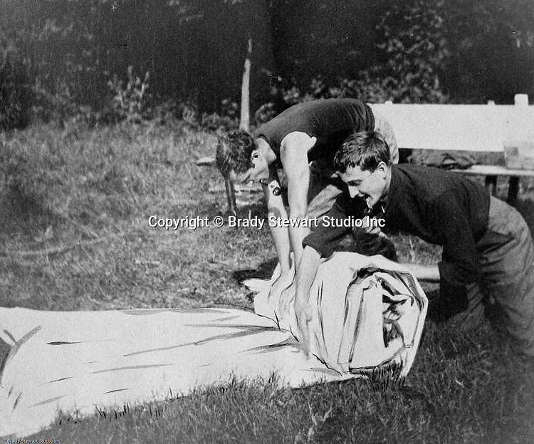 North East PA: Brady and Clark Stewart rolling up their tent after a camping trip to Lake Erie. During the early 1900s, the Stewart family vacationed on Lake Erie near North East Pennsylvania. Since hotels and motels were non-existent, camping was the only viable option for a large number of vacationers