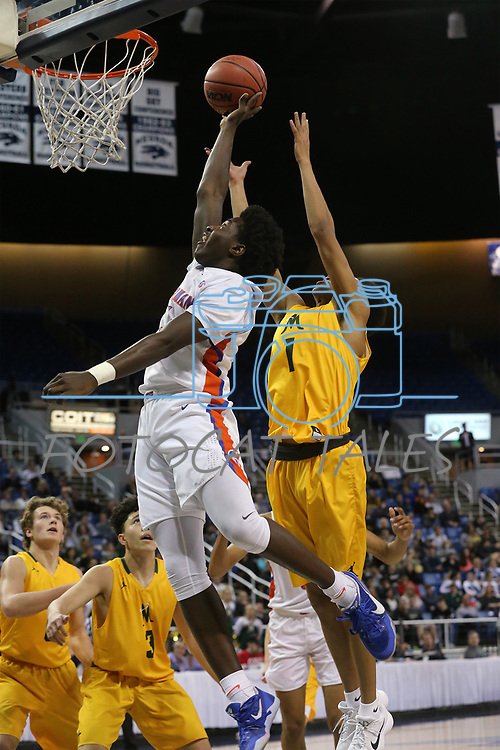 Bishop Gorman's William McClendon shoots past Bishop Manogue defender Joshua Rolling in the 4A NIAA state basketball championship game in Reno, Nev., on Friday, Feb. 23, 2018. Gorman won 62-41. Cathleen Allison/Las Vegas Review-Journal