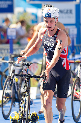 21 JUL 2013 - HAMBURG, GER - Alistair Brownlee (GBR) of Great Britain leaves transition at the start of his  bike leg during the ITU 2013 Mixed Relay Triathlon World Championships in the Altstadt Quarter, Hamburg, Germany (PHOTO COPYRIGHT © 2013 NIGEL FARROW, ALL RIGHTS RESERVED)