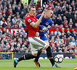 Phil Jones of Manchester United clashes with Wayne Rooney of Everton during the premier league match at the Old Trafford Stadium, Manchester. Picture date 17th September 2017. Picture credit should read: Simon Bellis/Sportimage