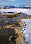 Yellowstone National Park, WY:<br /> Travertine and snow patterns at Upper Terraces of Mammouth Hot Springs