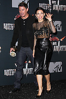 LOS ANGELES, CA, USA - APRIL 13: Channing Tatum, Jenna Dewan-Tatum in the press room at the 2014 MTV Movie Awards held at Nokia Theatre L.A. Live on April 13, 2014 in Los Angeles, California, United States. (Photo by Xavier Collin/Celebrity Monitor)