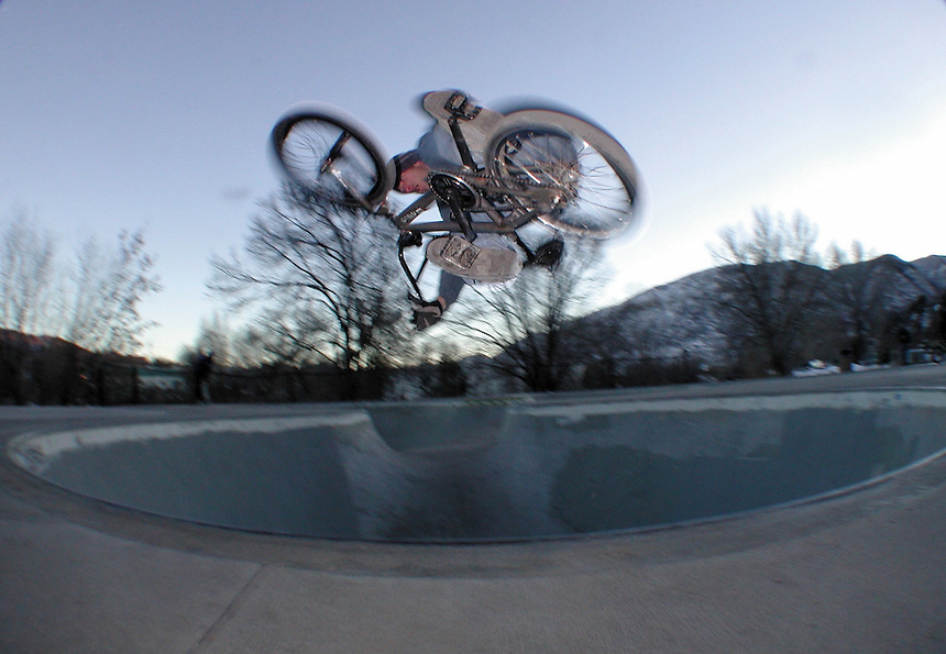 BMX rider Mac Milne gets inverted out of an 8' cement bowl in Durango, Colorado in December, 2001.