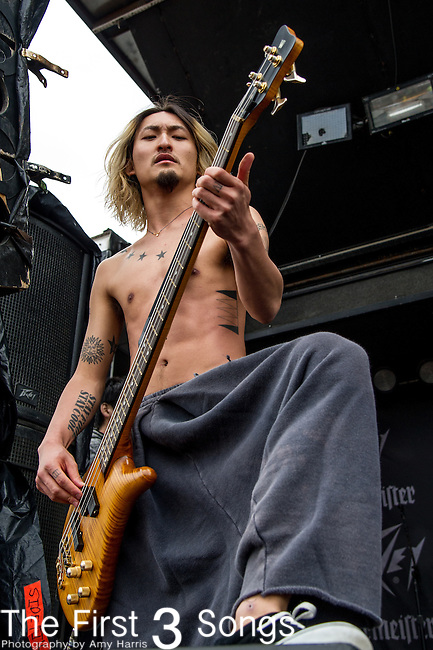 Ryota Kohama of One Ok Rock performs during the 2014 Rock On The Range festival at Columbus Crew Stadium in Columbus, Ohio.