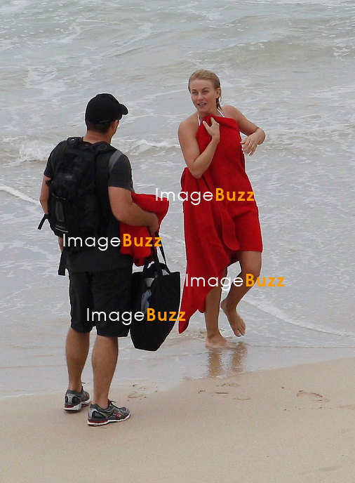 RYAN SEACREST & JULIANNE HOUGH IN ST. BARTHS - Ryan Seacrest and Julianne Hough enjoyed some fun in the sun in the Caribbean island of St. Barts..The high-profile couple spent some quality time together over the weekend before they both get back to their busy lives once again. The former ?Dancing with the Stars? pro looked like she was enjoying herself as she splashed in the ocean in a little white bikini on Friday. Her 38-year-old beau also donned a swimsuit and dove into the water. The lovebirds also did some paddleboarding on the high seas together and was said to be spending some time aboard a luxurious yacht as part of their vacation. January 4, 2013.