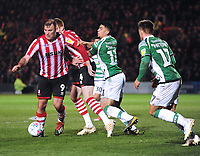 Lincoln City's Matt Rhead shields the ball from Yeovil Town's Courtney Duffus<br /> <br /> Photographer Andrew Vaughan/CameraSport<br /> <br /> The EFL Sky Bet League Two - Lincoln City v Yeovil Town - Friday 8th March 2019 - Sincil Bank - Lincoln<br /> <br /> World Copyright © 2019 CameraSport. All rights reserved. 43 Linden Ave. Countesthorpe. Leicester. England. LE8 5PG - Tel: +44 (0) 116 277 4147 - admin@camerasport.com - www.camerasport.com