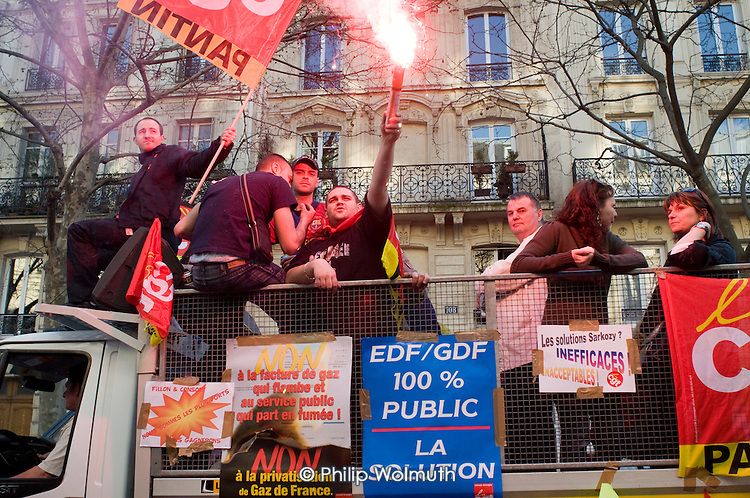Electricity and gas workers march  in Paris, joining up to 3 million people across France during a national strike against the Sarkozy government's economic policies.