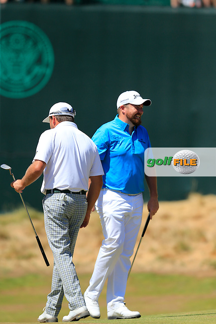 Graeme McDowell (NIR) and Shane LOWRY (IRL) have some fun on the 12th green during Wednesday's Practice Day of the 2015 U.S. Open 115th National Championship held at Chambers Bay, Seattle, Washington, USA. 6/17/2015.<br /> Picture: Golffile | Eoin Clarke<br /> <br /> <br /> <br /> <br /> All photo usage must carry mandatory copyright credit (&copy; Golffile | Eoin Clarke)